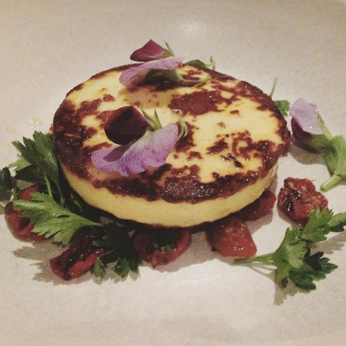 House made haloumi with sundried tomatoes and edible flowers