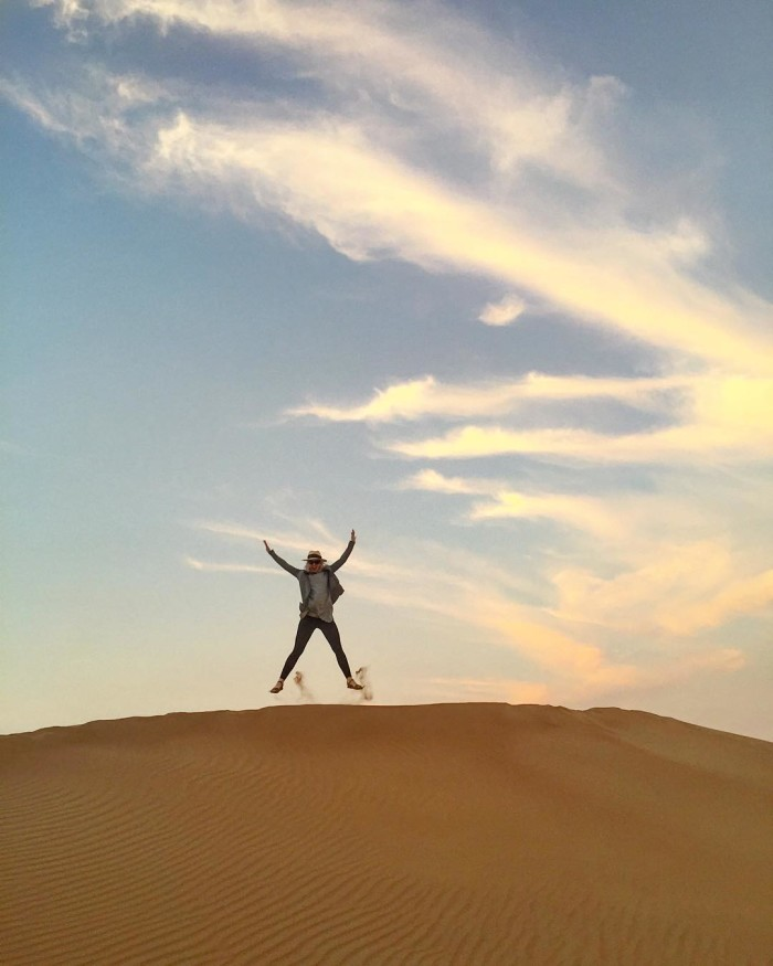 Jumping for joy as the sun sets over the deserthellip