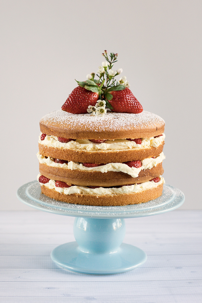 Decorating A Sponge Cake With Strawberries