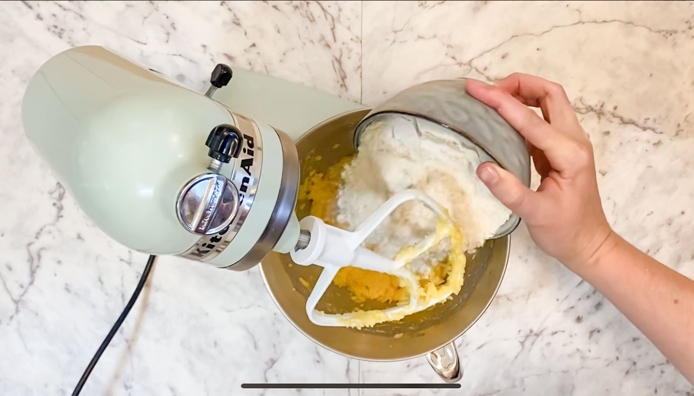 Adding flour to stand mixer and combining