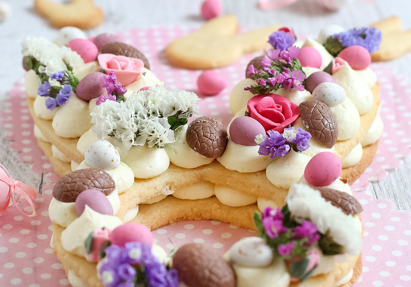 Close up of Easter Bunny Cream Tart with chocolate and flowers