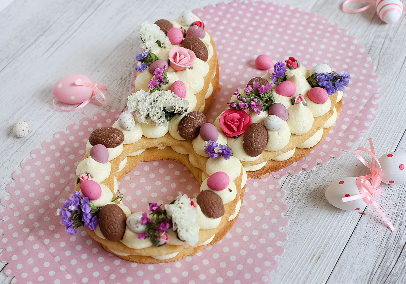 Close up of Easter Bunny Cream Tart surrounded by Easter eggs